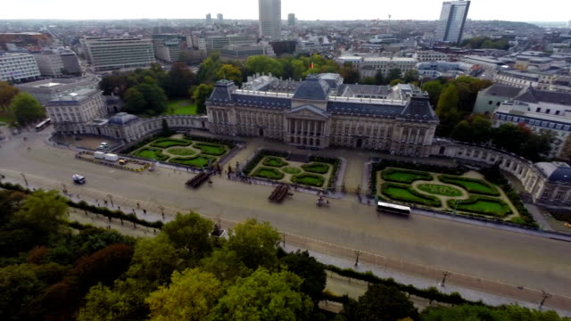 Royal Palace of Brussels marching cavalry aerial city view fly. Beautiful aerial shot above Europe, culture and landscapes, camera pan dolly in the air. Drone flying above European land. Traveling sightseeing, tourist views of Belgium. video