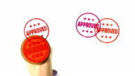 APPROVED rubber stamped on to screen video