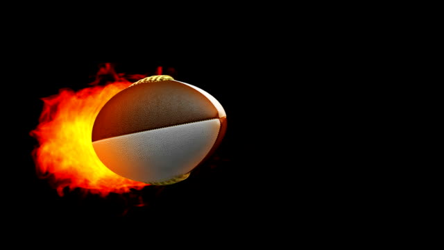 Rugby fireball in flames on black background video