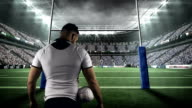 Rugby player holding the ball video