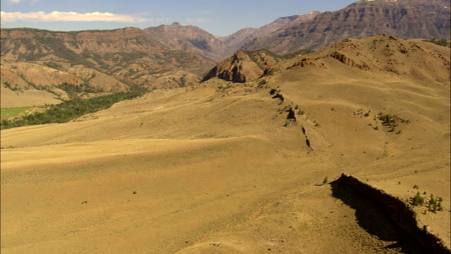 Rugged Landscape Either Side Of the North Fork Shoshone River  - Aerial View - Wyoming,  Park County,  helicopter filming,  aerial video,  cineflex,  establishing shot,  United States video