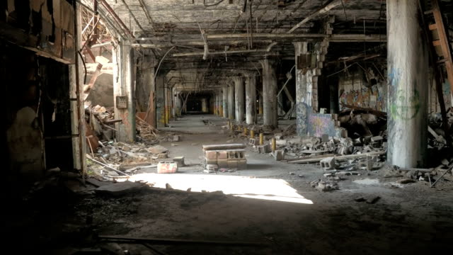 CLOSE UP Ruined garage in derelict Fisher Body Plant automotive factory, Detroit video