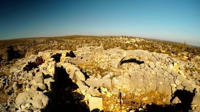 Ruins with polygonal laying of Turkey famous landmark far mountains blue sky Adamkayalar Mersin province Turkey video