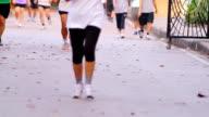 runner feet jogging outdoors video