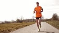 SLO MO TS Runner running on a road video