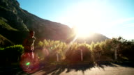 Runner sprinting in slow motion on mountain road video