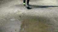 Runner step in to a water and drops flying video