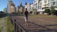 Runner training at the open air. On the backgroung orthodox temple video