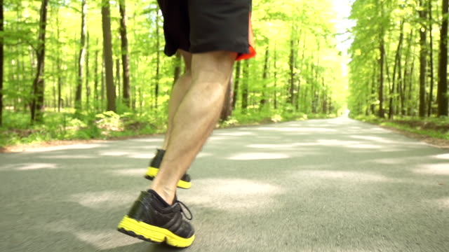 HD SUPER SLOW-MO: Runner's Footwear On Forest Road video