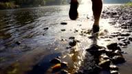 HD SUPER SLOW-MO: Runner's Footwear Splashing Water video