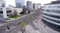 AERIAL: Runners on city streets running marathon video