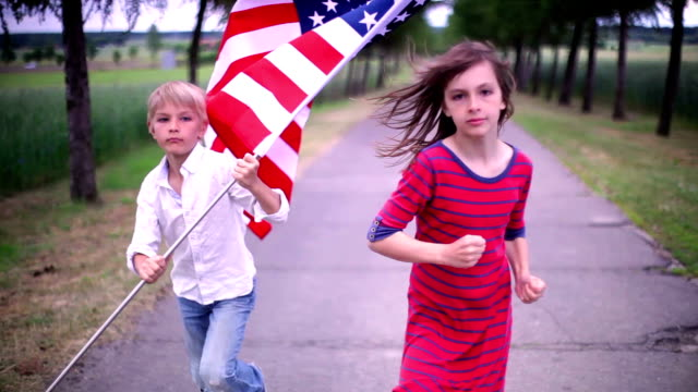 runners with a US flag video