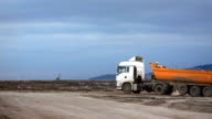 Running dump truck and horn noise at construction site video
