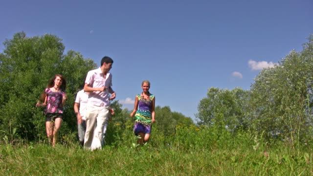 Running friends on grass video