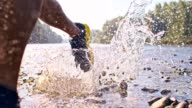 SLO MO Running in a shallow river video
