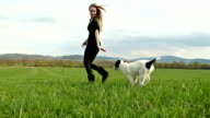 Running with dog friend on field video