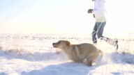 SLO MO Running With Puppy In Snow video