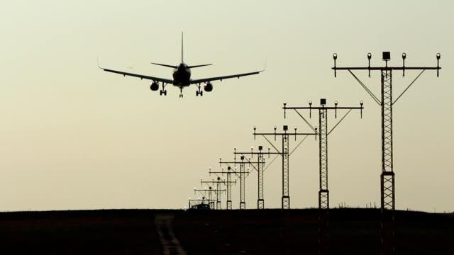 Runway lights and landing aircraft video