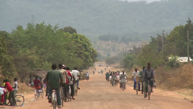 rural african road with many bicycles video