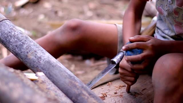 Rural boy making toy. video