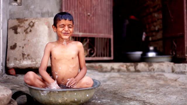 Rural child bathing video