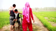 Rural Family going to the field with riding Bicycle video