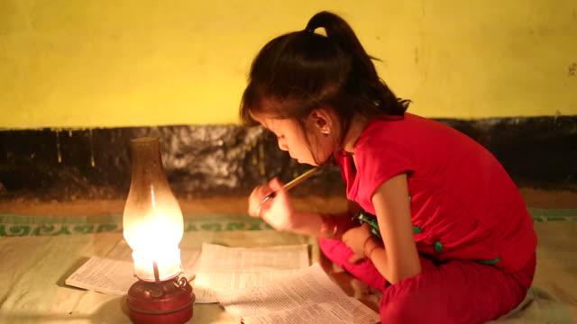 Rural girl studying in lantern video