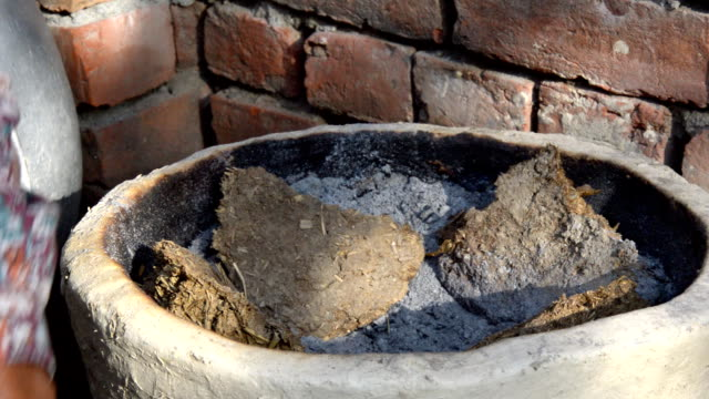 Rural Indian Cooking Process using Cow Dung Cakes video