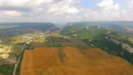 Rural Landscape With Harvest Field At Hilly Valley video