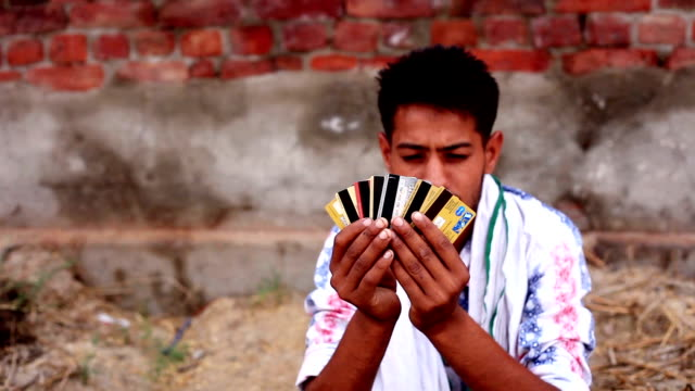 Rural men holding credit cards video