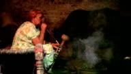 Rural village women enjoying Hookah at night in stable video