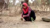 Rural women sweeping broom video