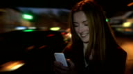 Rush hour smartphone, beautiful young woman reading text. video