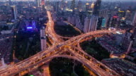 TL, WS Rush hour traffic on multiple highways and flyovers at night / Shanghai, China video