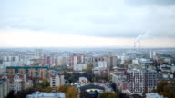 Russian industrial district - aerial panorama of autumn city in cloudy sky video
