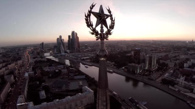 Russian skyscrapers flight over aerial view. Stalin high rise building. Ukraine hotel. Radisson hotel. Moscow city business center. Skyscrapers of the Moscow International Business Center (Moscow-City) and the Moskva River at the sunset or sunrise. video