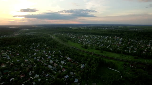 Russian village and moving cargo train, aerial view video