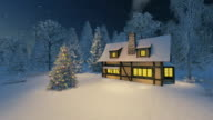 Rustic house and decorated christmas tree at night video