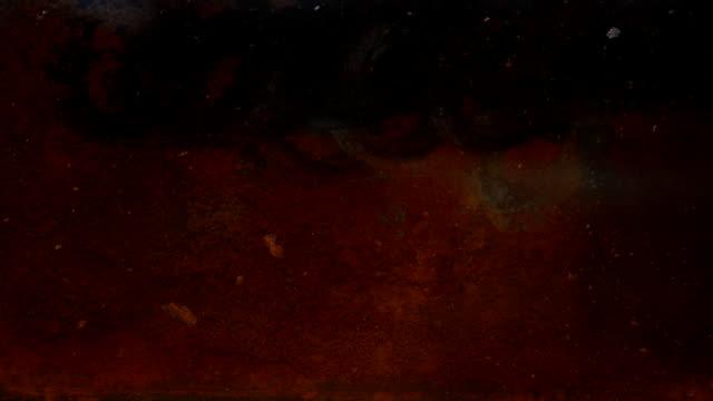 Rusty sheet of metal in the water. video