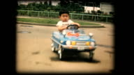60's 8mm footage - Boy playing with a toy car video