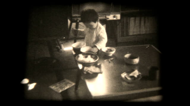 60's 8mm footage - young boy eating with spoon video