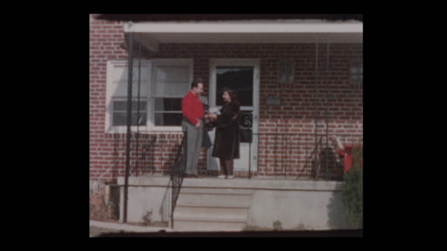 50's Couple with woman in fur coat leave house video
