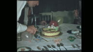 50's dad slices birthday cake for family video