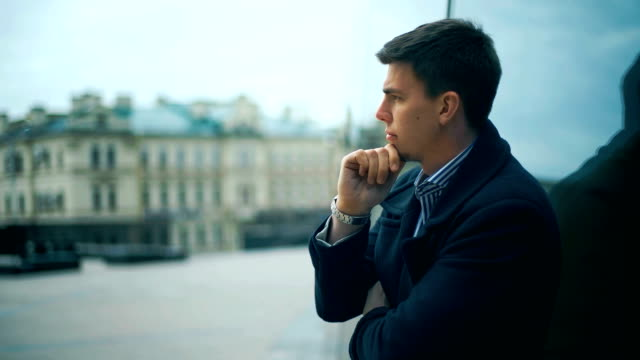 A sad and depressed businessman standing alone outdoors. video