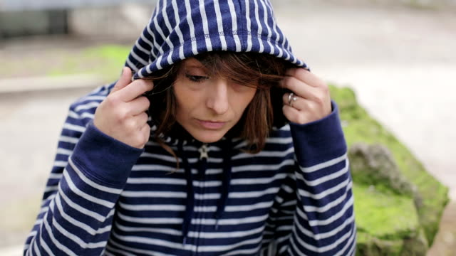 Sad and depressed woman deep in thought outdoors video