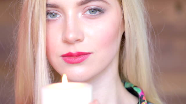 Sad attractive young women with candle in arms. Never again. Feel pain, lost someone video