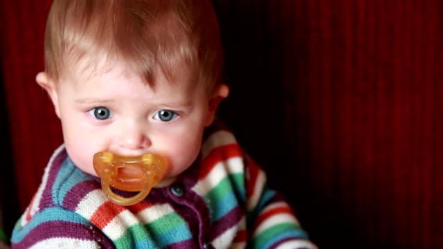 Sad baby sucking pacifier video