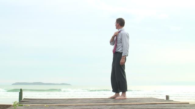 Sad businessman at the sea video