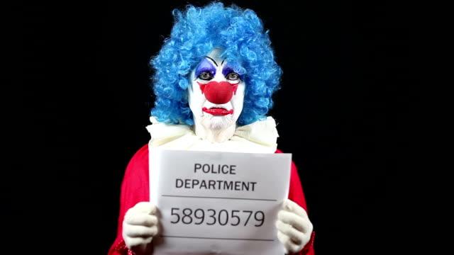 Sad Clown Getting Mugshot Taken video