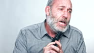 Sad, depressed businessman video